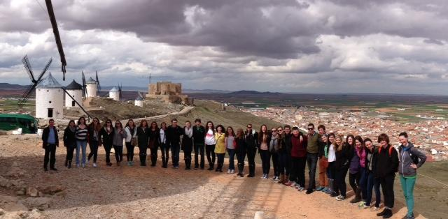 Students pose outside of a landmark in Spain.
