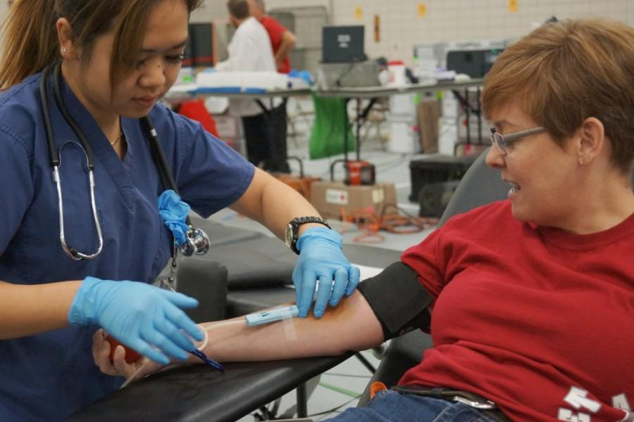 EHS French teacher Mme. Caster gets her blood drawn.