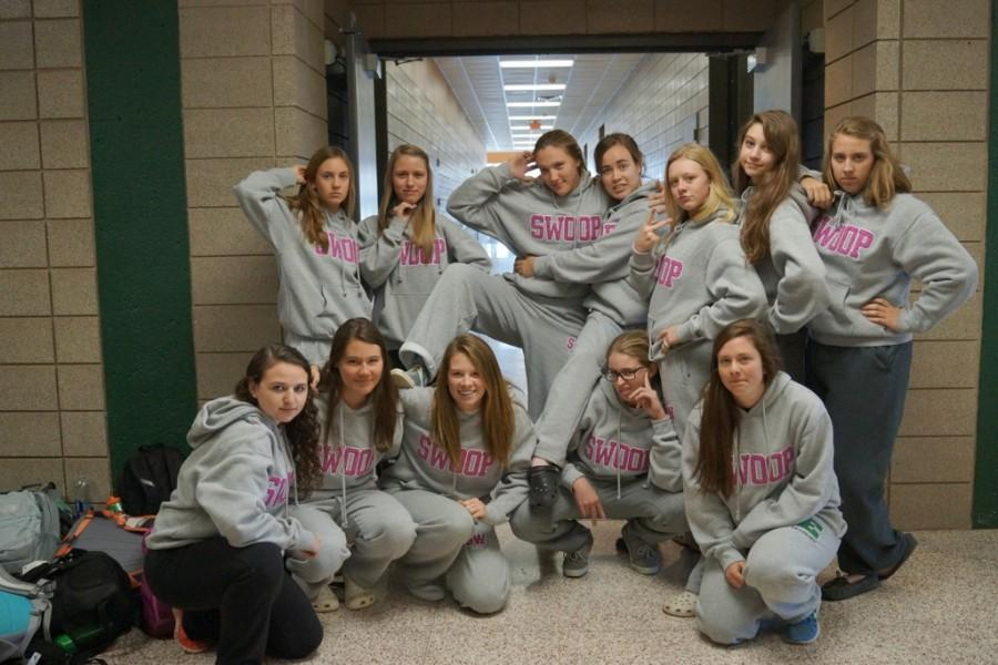 A large group of EHS seniors pose show off their SWOOP outfits.