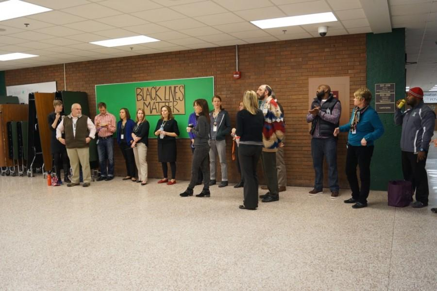 The teachers showed their support in the cafeteria during all three lunches.