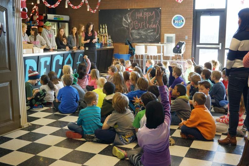 DECA Students Teach Second Graders Business Basics