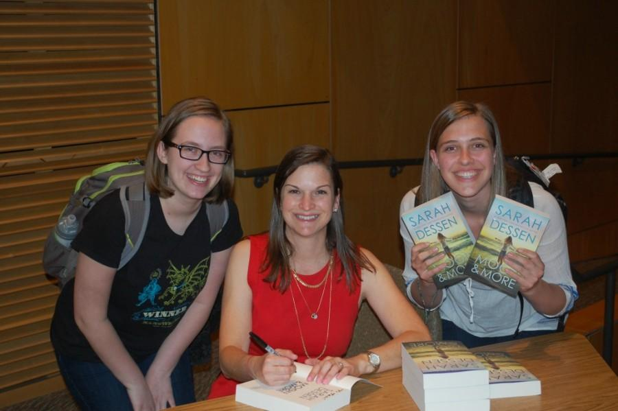 Author Sarah Dessen signs books for juniors Tess Lydon (left) and Cristiana Hawthorne (right).