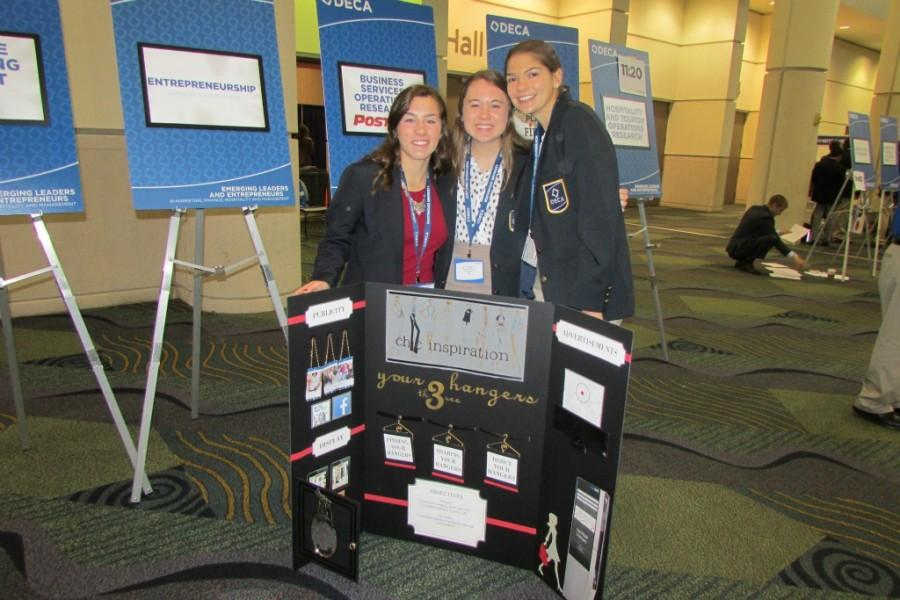 Three DECA competitors from last year at a conference