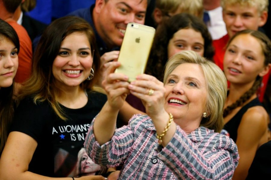 Clinton taking a selfie with voters