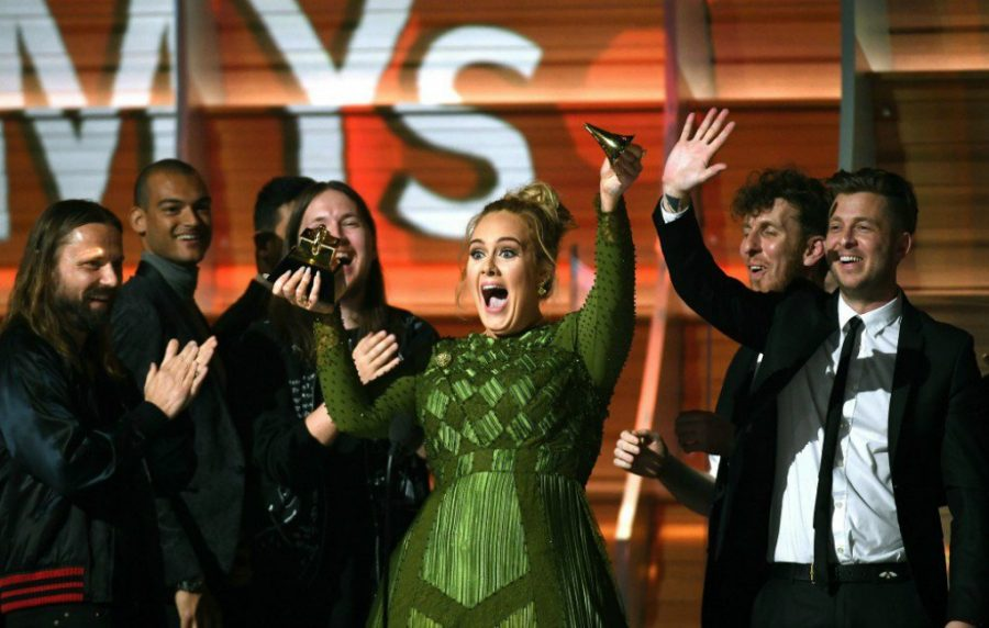 Adele Breaks Grammy to share with Beyoncé