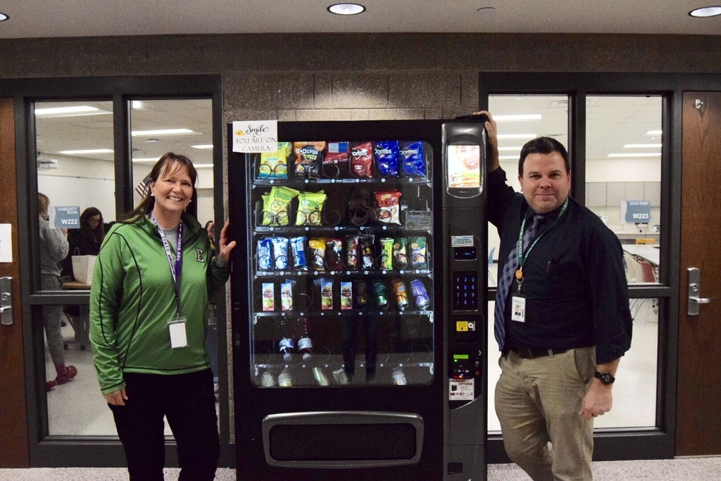 Principal Andy Beaton (right) recently signed a contract with Midwest Vending to provide a small discretionary income for EHS. Pam Berling (left) poses with a new machine.