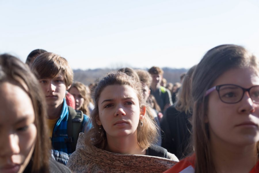 Students listen to the speeches given during the March 14 walkout.