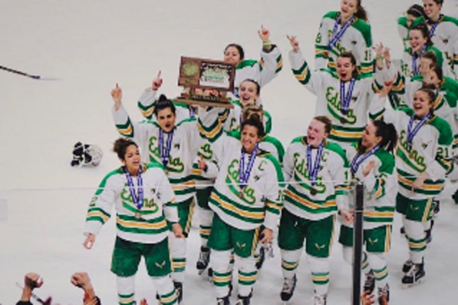 EHS Girls Hockey Team celebrates after winning their second consecutive State Championship.