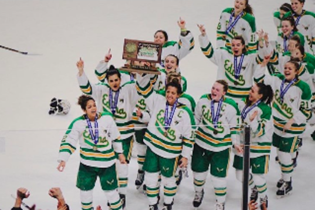EHS Girls' Hockey Team celebrates after winning their second consecutive State Championship.