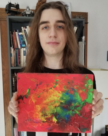 "Duin holds up one of his favourite paintings, titled ""Light Up The Day."""