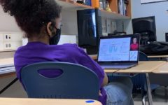 Working hard or hardly working?: A student focuses on their current science unit.